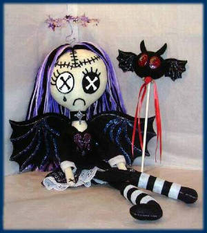 sweetgothicangelsittingdoll1.jpg